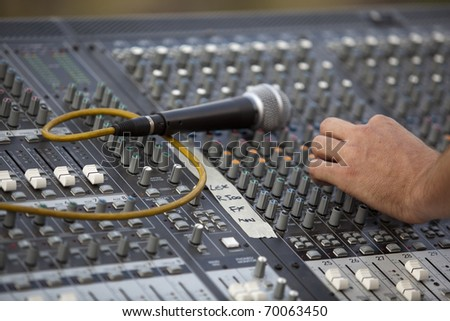 Audio mixer with hand and microphone