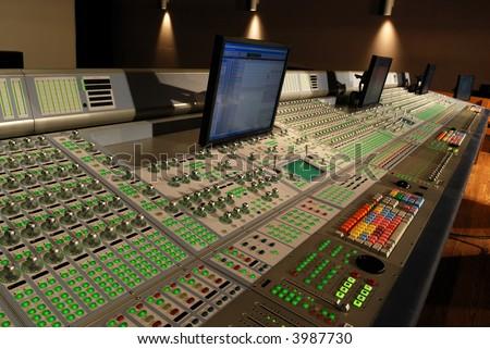 audio mixing console in studio