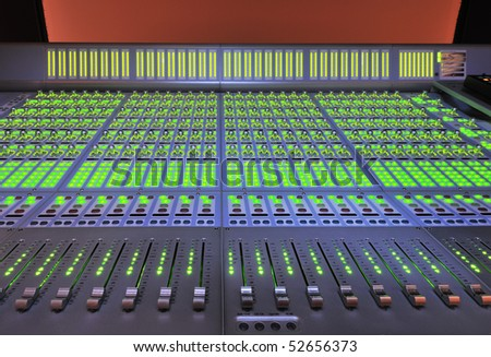 audio post production mixing console with lights on