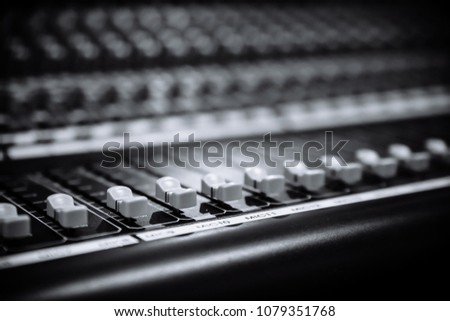 Audio sound mixer&amplifier equipment, sound acoustic musical mixing&engineering concept background. Sound mixer buttons control in recording room, black&white, selective focus