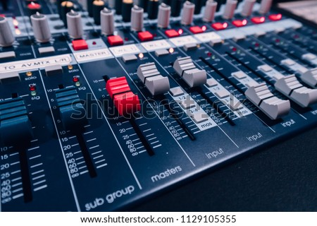 Audio sound mixer&amplifier equipment, sound acoustic musical mixing&engineering concept background. Sound mixer buttons control in recording room, selective focus. color tone