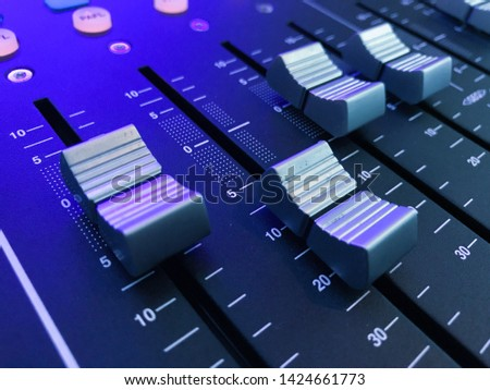 Audio sound mixer and amplifier equipment, Mixers Audio Interfaces Blue light tone  concept background, Digital sound mixer, selective focus