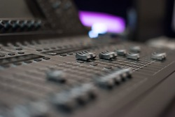 Audio sound mixer console. Audio mixer, music equipment. broadcasting tools, mixer, synthesizer. and computer control.Professional sound and audio mixer control panel with buttons and sliders.