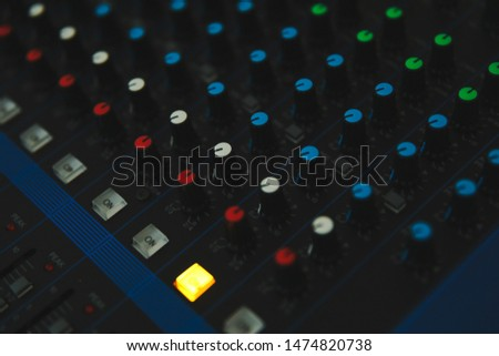 Audio sound mixing console control panel and buttons of digital studio turntable dj mixer.