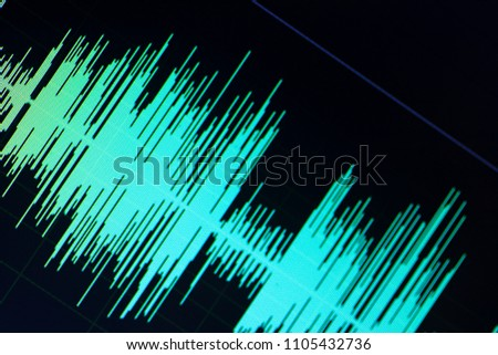 Audio sound wave studio editing computer program screen showings sounds on screen from vocal recording of voiceover. #1105432736