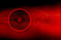 Audio speaker on a red grunge background