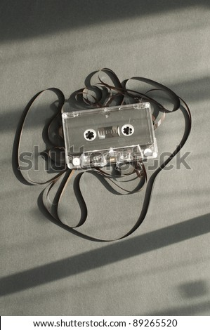 Audio tape cassette with subtracted out tape. Old broken cassette