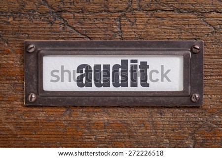 audit  - file cabinet label, bronze holder against grunge and scratched wood