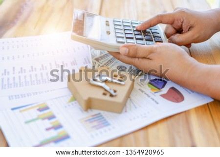 Auditing inspectors are checking accounting and tax reports to submit loans to buy houses from customers' financial documents for accuracy before purchasing a home in the agreement before contracting.