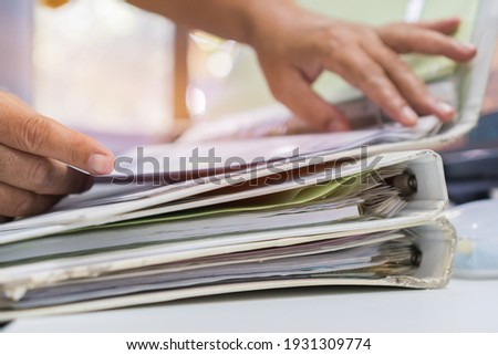 Auditor businesswoman checking searching document legal prepare paperwork or report for analysis information in TAX time, accountant in workload data contract partner deal in workplace at office