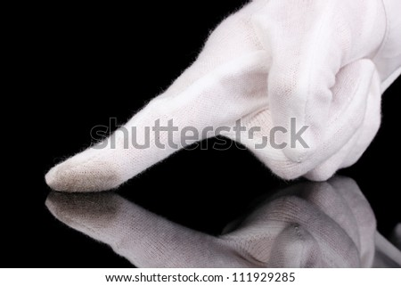 Auditor hand checking cleanliness isolated on black