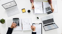 Auditors Calculating Corporate Invoicing And Tax Budget