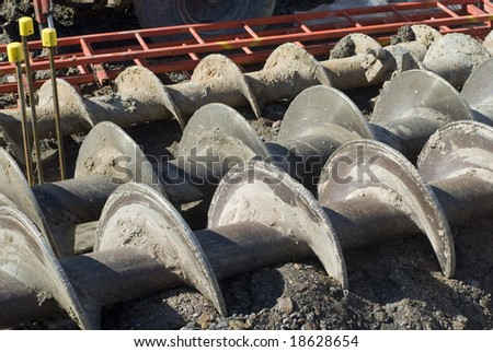 augers used to dig deep foundations for a building