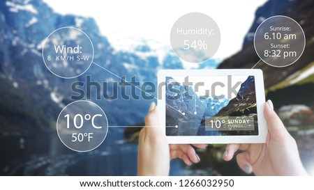 Augmented Reality information technology is displayed on tablet in mountain. Weather station data logging wireless monitoring, tracking and forecasting temperature, humidity. #1266032950