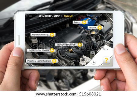 Augmented reality marketing concept. Hand holding smart phone use AR application to check maintenance car engine for customer.
