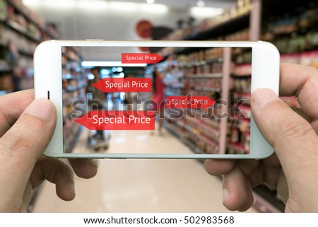 Augmented reality marketing concept. Hand holding smart phone use AR application to check special price in retail store