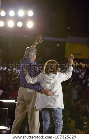 AUGUST 2004 - Senator and Mrs. John Kerry waving from stage at Heritage Square, Flagstaff, AZ