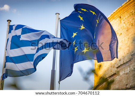 AUGUST 2017, THESSALONIKI GREECE: Greek flag and European Flag blowing in the wind one next to another #704670112