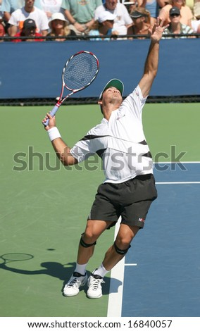 August 25, 2008 - US Open, New York: Ivan Navarro of Spain completing a serve - stock photo