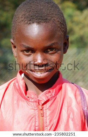 August 20, 2014-Village Pomerini-Tanzania-Africa-African child sick of the virus AIDS, helped by the Friars of the Franciscan Mission to give him the necessary medicines, a smile and a possible future