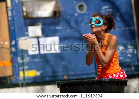 AURILLAC, FRANCE - AUGUST 23: A comedian is wearing funny glasses as part of the Aurillac International Street Theater Festival,show by the Company Empreintes, on August 23, 2012, in Aurillac,France.