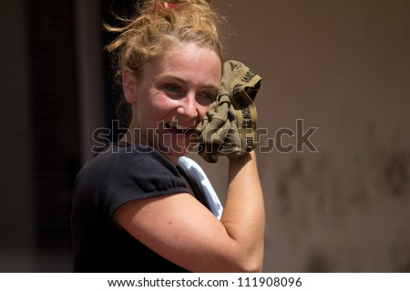 AURILLAC, FRANCE - AUGUST 23: a woman is wiping his face with a boxer shorts,Auurillac International Street Theater Festival, Company Les Anomalyques ,on august 23, 2012, in Aurillac,France.