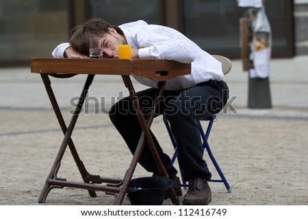 AURILLAC, FRANCE - AUGUST 24: an actor is lying on a table as part of the Aurillac International Street Theater Festival, show by the Schizophr�¨nes associ�©s, on august 24, 2012, in Aurillac,France.