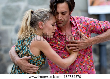 AURILLAC, FRANCE - AUGUST 23: An embracing couple dances tango, as part of the Aurillac International Street Theater Festival, cie Moebius, on august 23, 2013, in Aurillac,France