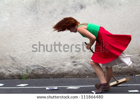 AURILLAC, FRANCE - AUGUST 24 : dancer holding a broom as part of the Aurillac International Street Theater Festival,show by the Company D'Akipaya Danza , on august 24, 2012, in Aurillac,France.