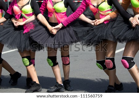 AURILLAC, FRANCE - AUGUST 22 :Group of dancers wearing a black tutu as part of the Aurillac International Street Theater Festival, Ballets Temps Dance Jr Cie , on august 22, 2012, in Aurillac,France.