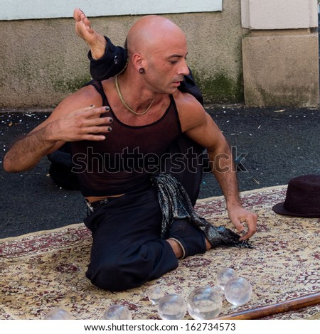 AURILLAC, FRANCE - AUGUST 23: Portrait of a very supple street performer, named Jyoti, as part of the Aurillac International Street Theater Festival, on august 23, 2013, in Aurillac,France