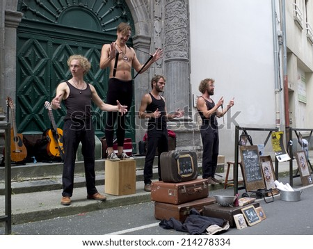 AURILLAC, FRANCE- AUGUST 20: some funny street performers play as part of the Aurillac International Street Theater Festival, show by cie les trois coups,on august 20, 2014, in Aurillac,France.