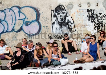 AURILLAC, FRANCE - AUGUST 22: Spectators waiting for the show of Groupe Berthe as part of the Aurillac International Street Theater Festival, on august 22, 2013, in Aurillac,France