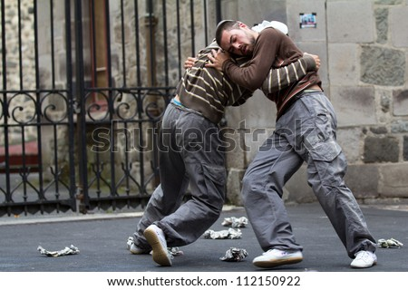 AURILLAC, FRANCE - AUGUST 24: two masked dancers fight in the street as part of the Aurillac International Street Theater Festival,show by the Company Idem,on august 24, 2012, in Aurillac,France.