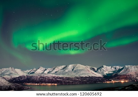 Aurora above fjords in Norway