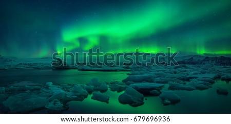 Stock Photo Aurora borealis above Jokulsarlon glacier lagoon, Iceland