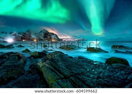 Aurora borealis above snowy islands of Lofoten #604599662