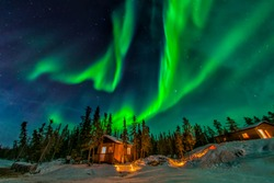 Aurora borealis flying over the chalet in Yellowknife