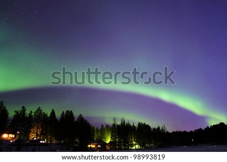 Aurora borealis in Lapland, Finland, around Levi town - stock photo