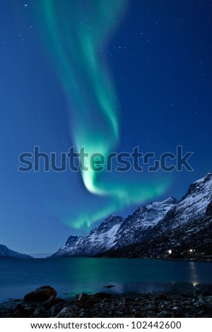 Aurora Borealis in Norway reflecting in the water