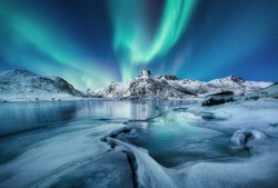 Aurora Borealis, Lofoten islands, Norway. Mountains and frozen ocean. Winter landscape in the night time. Northen light - image