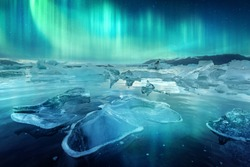 Aurora borealis northen light and icebergs in Jokulsarlon glacial lagoon. Vatnajokull National Park, southeast Iceland, Europe. Landscape photography
