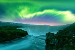 Aurora borealis Northern lights over Godafoss waterfall on Skjalfandafljot river, Iceland. Landscape photography. Courtesy of NASA. Photo collage