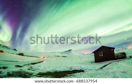 Aurora Borealis or better known as The Northern Lights for background view in Iceland, Reykjavik during winter #688537954
