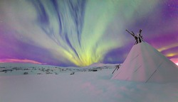 Aurora borealis or Northern lights    in the sky and triangle cloth tent -  Tromso, Norway