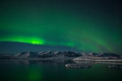Aurora Borealis or Northern Lights over the glacier lagoon Jokulsarlon, Iceland