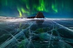 Aurora borealis over the ice of a frozen lake Baikal, Siberia, Russia