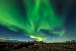 Aurora borealis over the Thingvellir National Park - Iceland