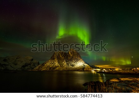 Aurora borealis (Polar lights) over the mountains in the North of Europe - Senja Island, Troms, Norway - Shutterstock ID 584774413