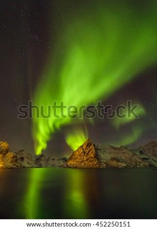 Aurora borealis (Polar lights). View to Reinefjorden on Senja island - Lofoten islands, Norway - Shutterstock ID 452250151